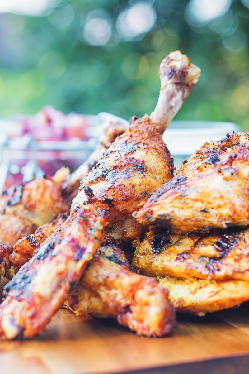 Tandoori Chicken legs on a chopping board