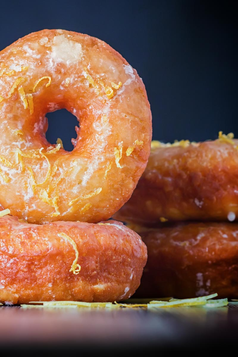 Portrait Image of lemon glazed ring donuts cooked from a basic donut recipe