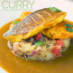Landscape image of a deconstructed fish curry with turmeric sea bream fillets on fenugreek potatoes with a curry sauce served on a white plate with text