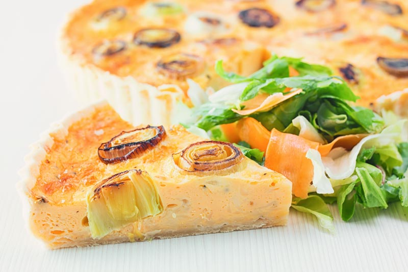 This Gruyere and Leek Quiche is a little play on the classic idea of a cheese and onion quiche using nutty almost smoky Gruyere cheese & charred leeks.