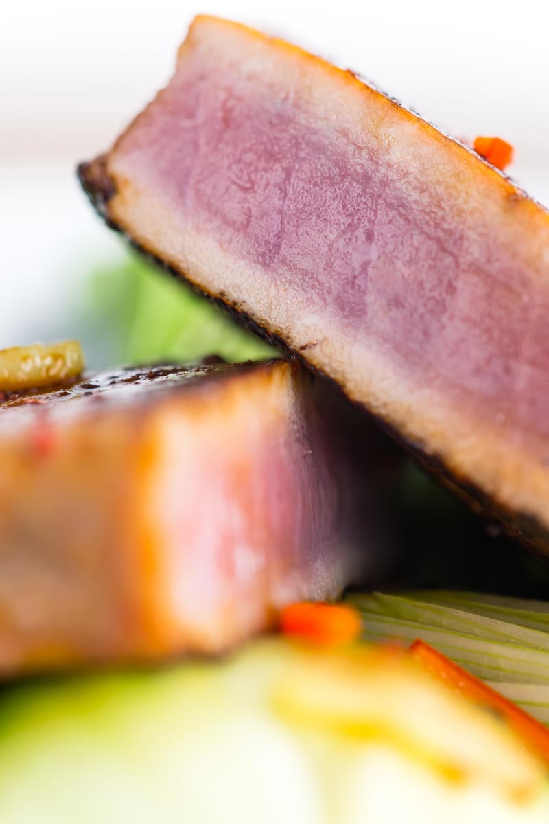 This glorious honey and soy glazed tuna steak is pimped up with a bit of chili and seared rather than cooked, it is served with some garlic braised pak choi and spring onions. #tuna #searedtuna