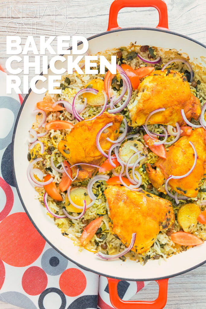 Tall close up overhead image of one pot chicken and rice featuring turmeric chicken thighs and red onion slivers with text