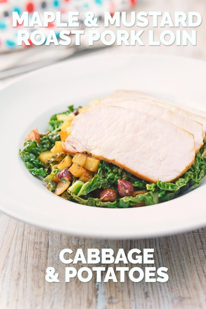 Tall image image of mustard roast pork on a bed of cabbage and golden fried potatoes and hazelnuts in a white bowl and spotted lined