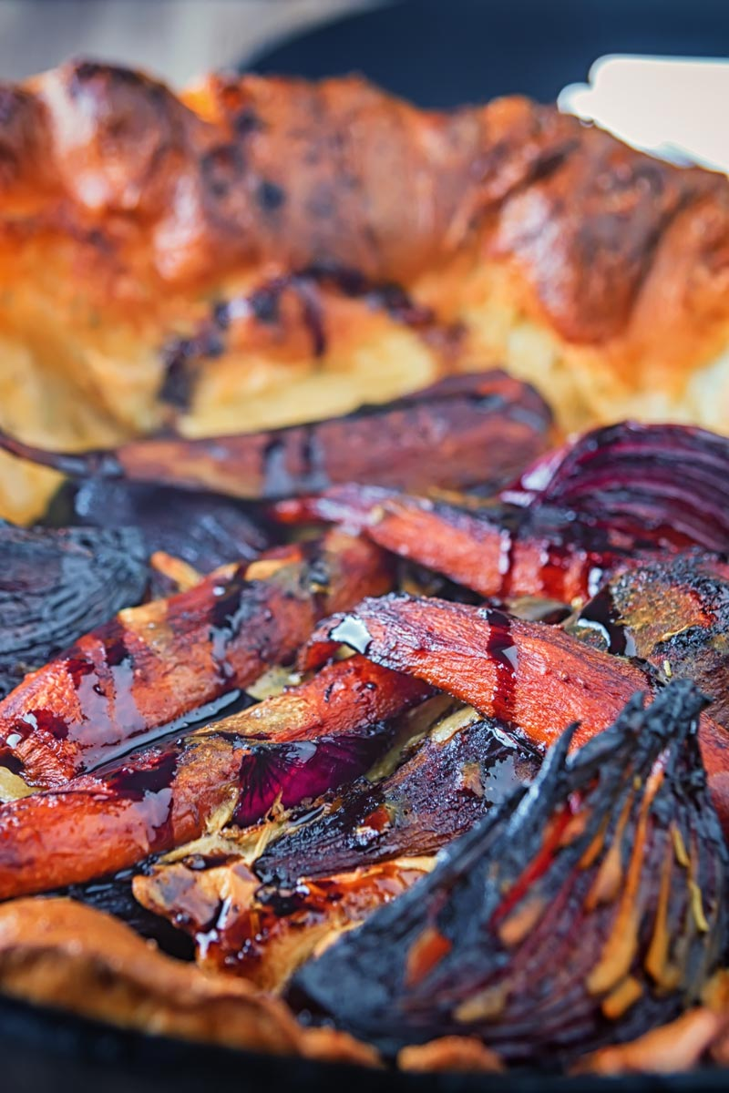 Close up portrait image of roasted vegetable toad in the hole