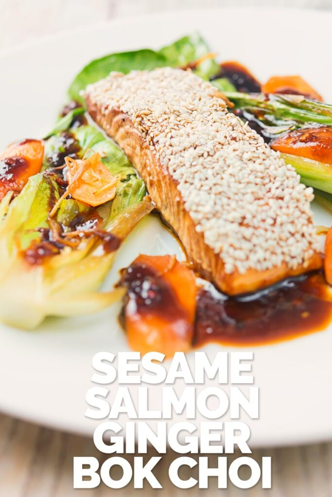 Portrait image of a sesame salmon fillet served with ginger bok choi and carrots on a white plate with text