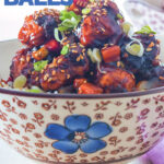 Close up portrait image of sweet and sour pork balls in an Asian style bowl decorated with a blue flower against a light backdrop with text