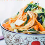 Close up portrait image of a bowl with Asian patterns containing sweet and sour Stir Fried Noodles with text