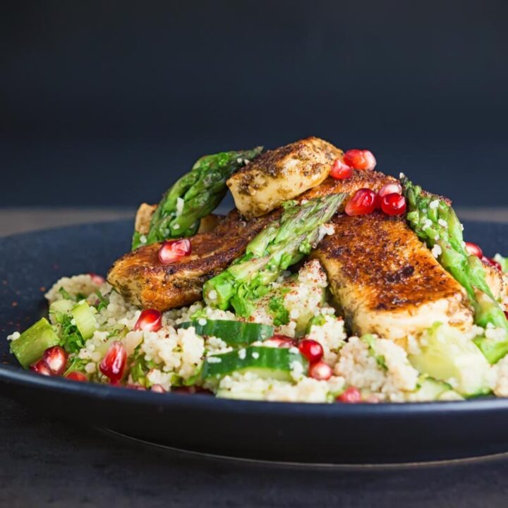 This Zaatar Halloumi Cheese With Cous Cous combines zaatar marinated and sautéd halloumi cheese with a fresh spring like jeweled couscous salad!