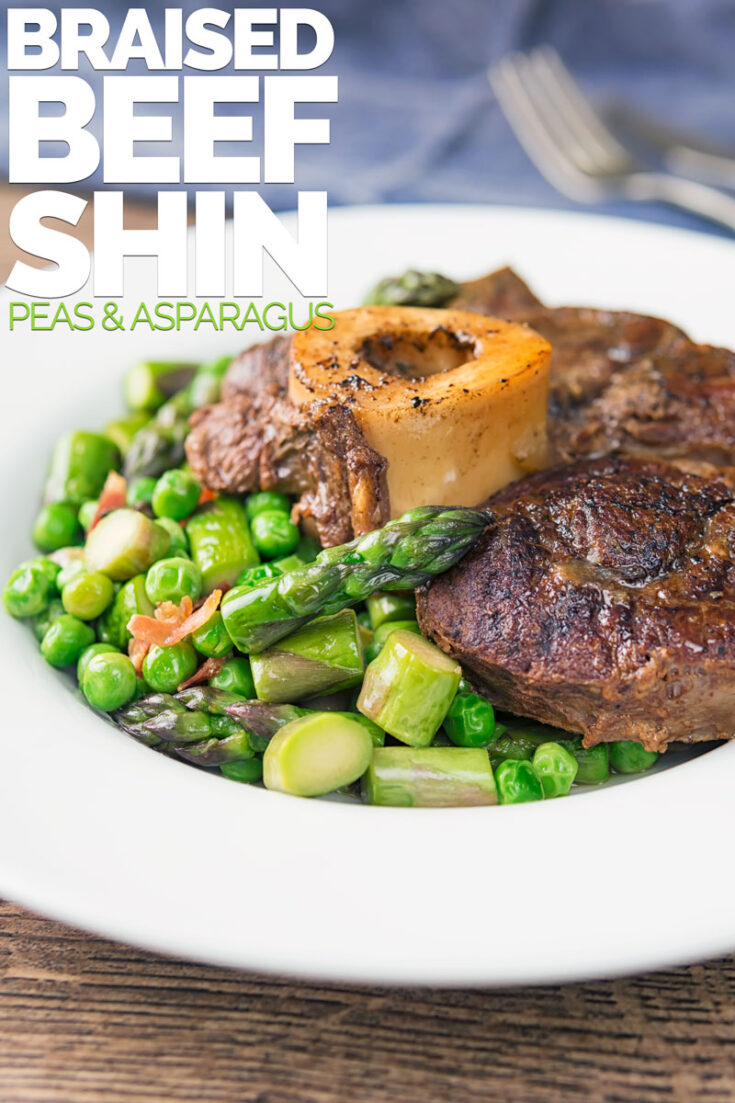 This simply braised beef shin steak is slowly simmered in aromats, beef stock and Worcestershire sauce until fork tender. Then it is served on a bed of peas and asparagus cooked in bacon and butter... Of course!