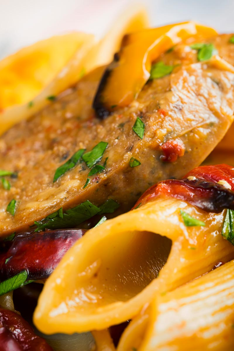 Portrait close up image of an Italian Sausage pasta with roasted peppers and penne pasta