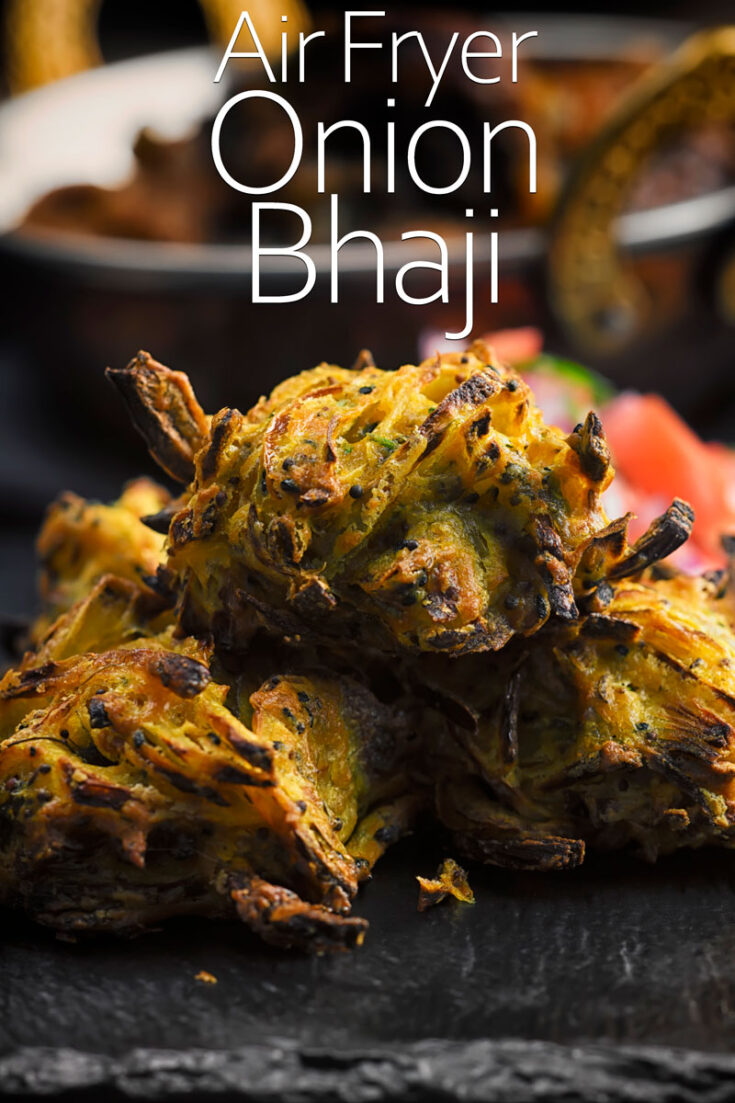 An onion bhaji or bhajiya as an Indian snack, starter or side that is in all but name a pakora. My version is generously spiced although not hot with chili and is cooked in an air fryer. Don't worry though I have frying instructions too!