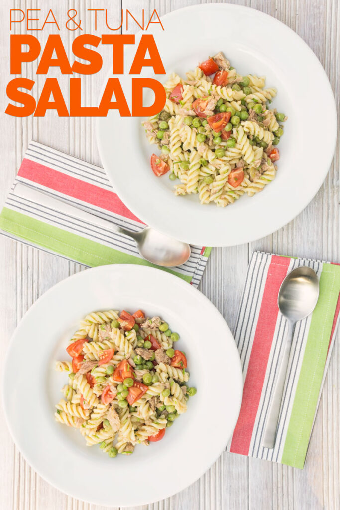 Portrait overhead image of a tuna pasta salad using fusilli pasta with cherry tomatoes and garden peas served in two white bowls with text