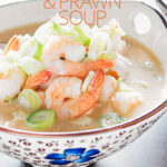 Landscape close up image of a chicken and prawn soup served in an Asian style bowl decorated with a blue flower with text