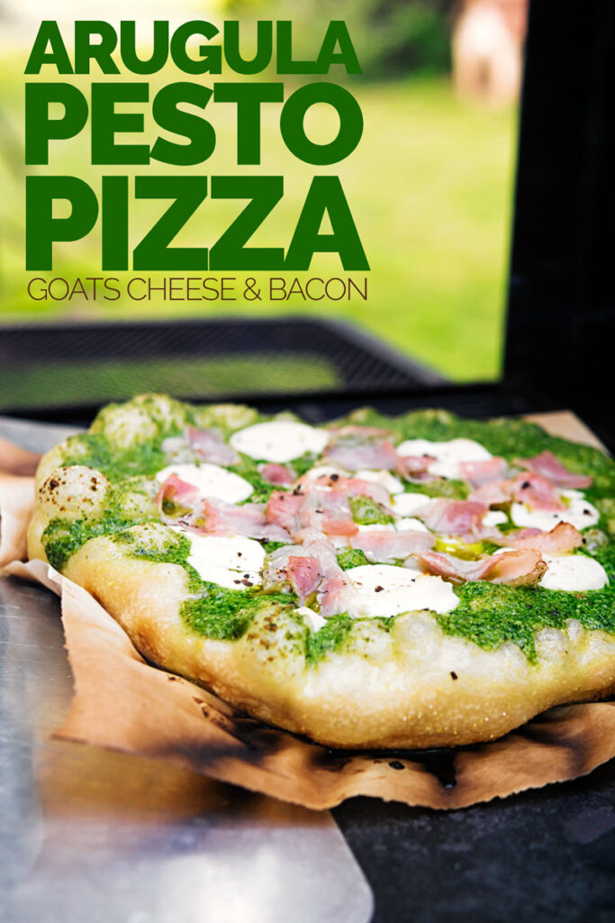 Portrait image of a Rocket Pesto Pizza with goats cheese and bacon cooked on a BBQ with text