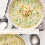 Portrait overhead image of two bowls of salmon chowder set against a light back drop with text overlay