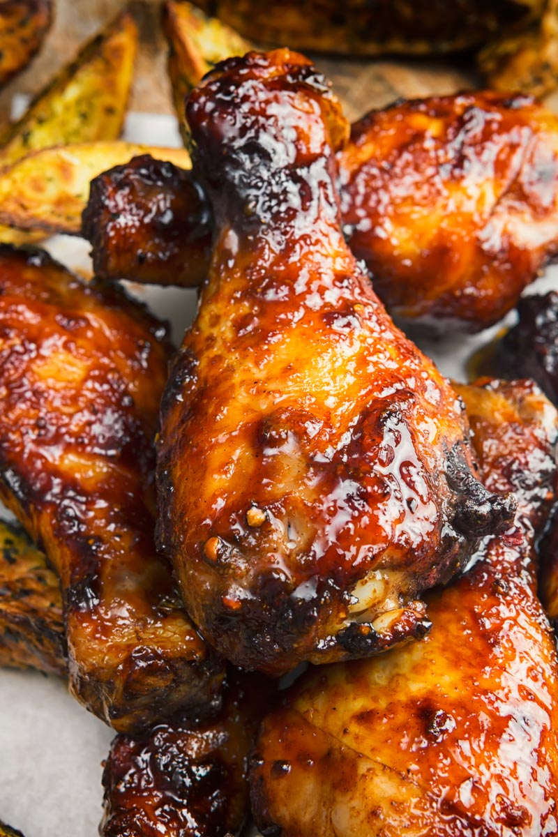 Portrait image of a sticky chicken drumsticks