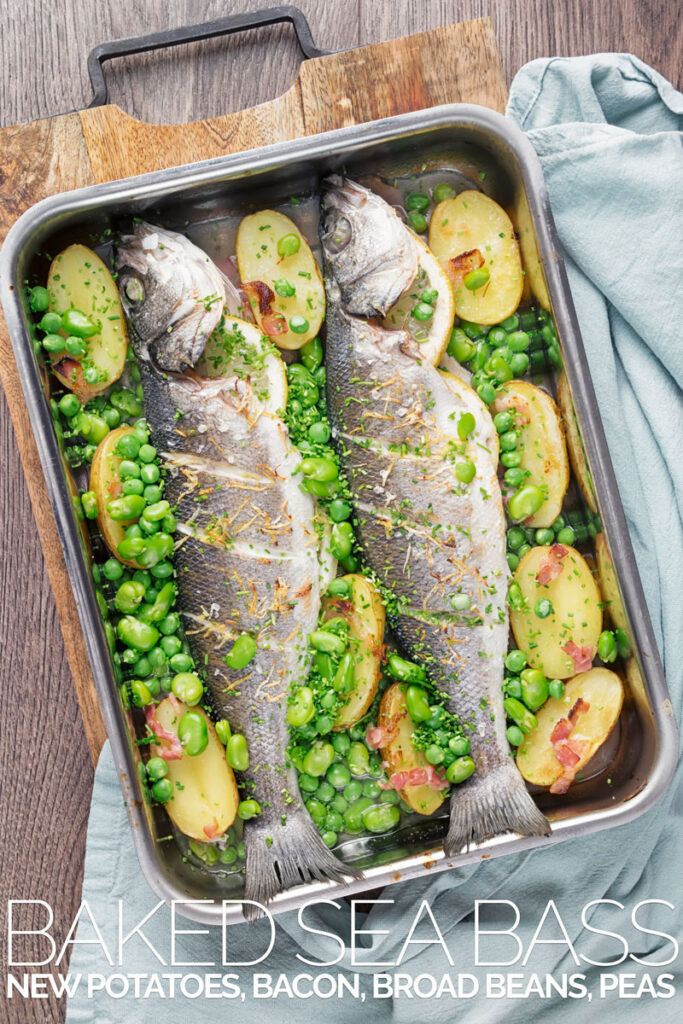 Portrait overhead image of two whole baked sea bass in a tray with potatoes peas and broad beans with text overlay