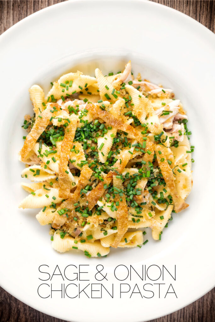 Portrait over head image of sage and onion chicken pasta served in a white bowl with text overlay