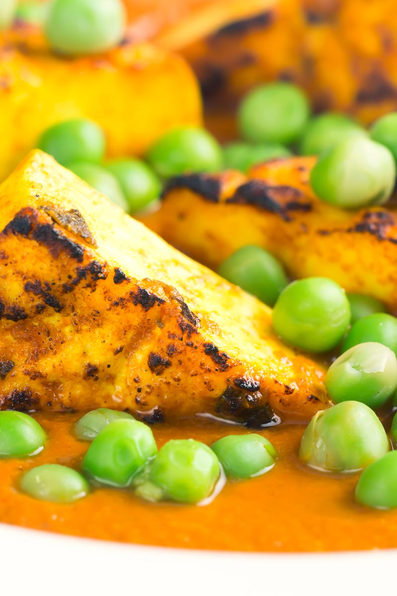 Portrait close up image of Matar Paneer Or Mutter Panner Indian Curry served in white bowl