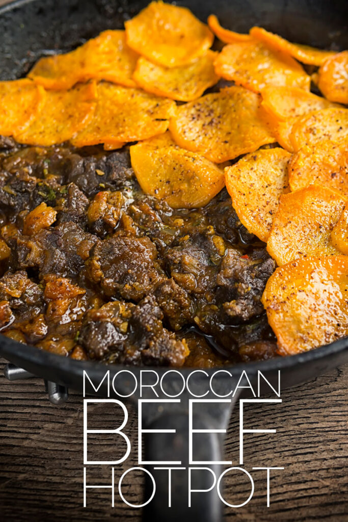 Portrait image of a beef hotpot served in a cast iron skillet with a sliced sweet potato topping with text overlay