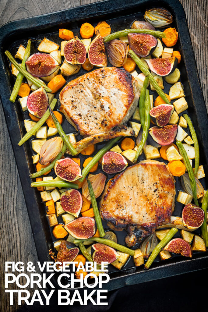 Portrait overhead image of a pork chop tray bake featuring fresh figs, green beans, shallots, carrots and parsnips with text overlay