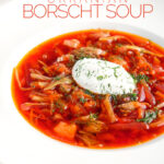 Portrait image of a Russian Borscht Soup served in a white bowl with sour cream and dill with text overlay
