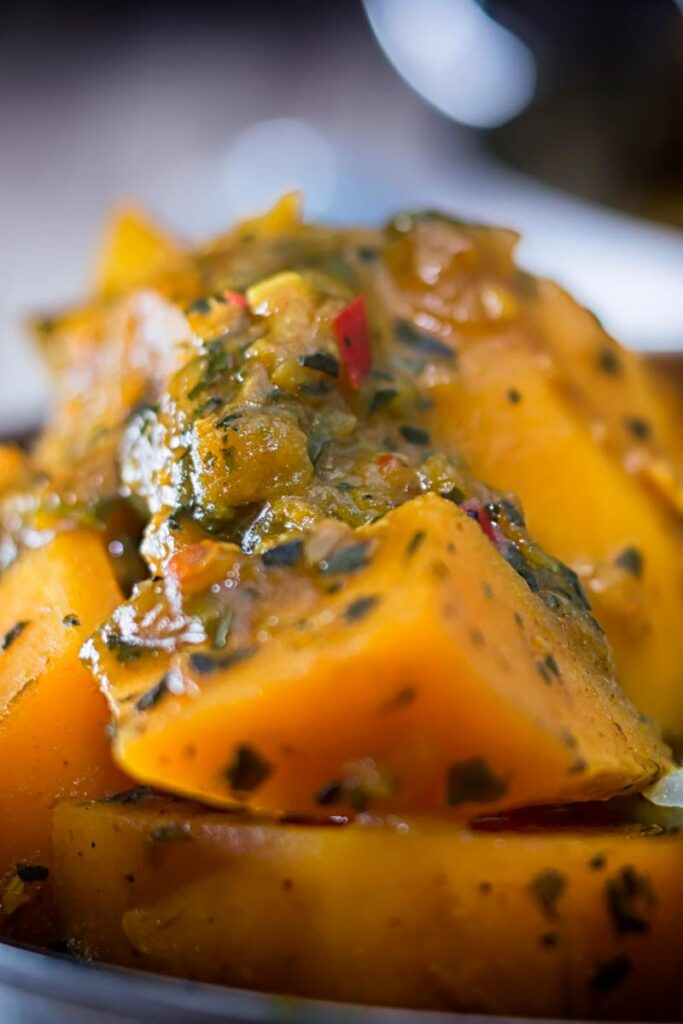 Portrait close up image of a steaming hot pumpkin curry