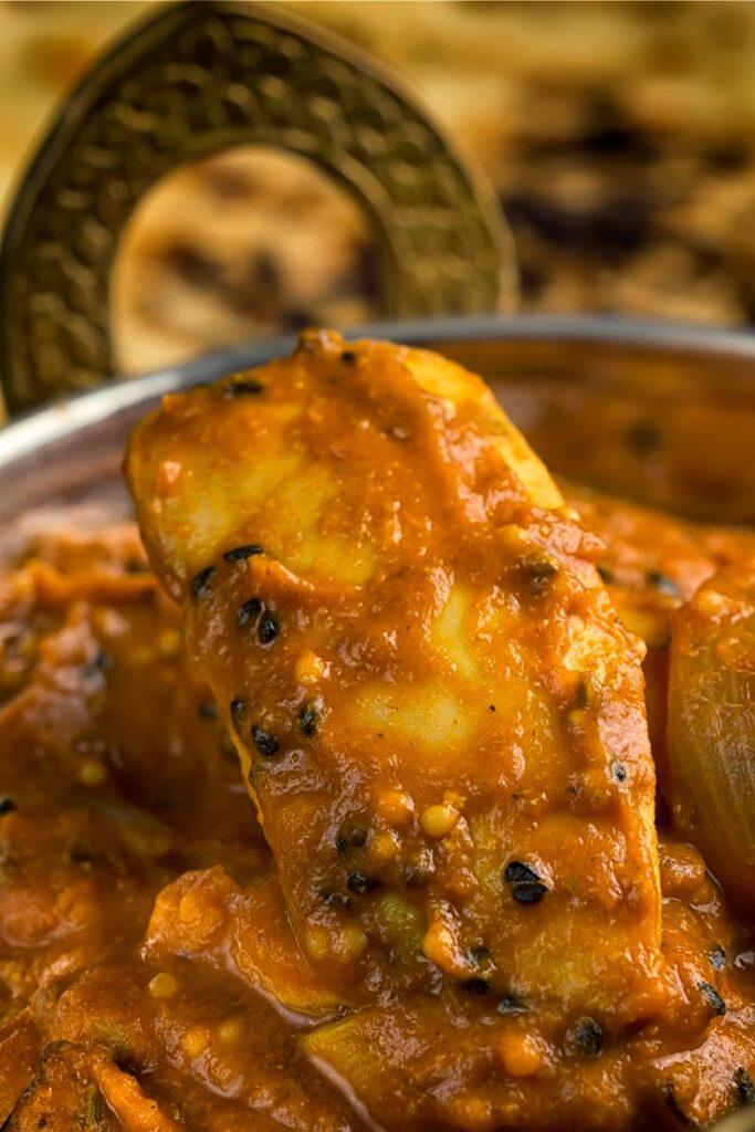 Portrait close up image of a chicken jalfrezi curry