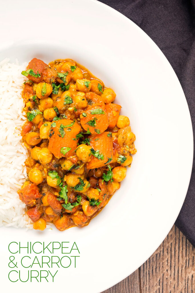 Overhead portrait image of a chickpea and carrot curry served with basmati rice served in a white bowl with text overlay.