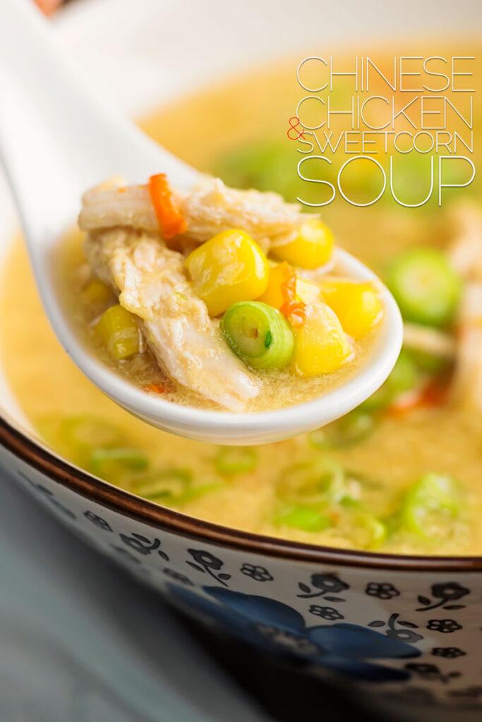Portrait close up image of a Chinese chicken and sweetcorn soup served in an asian bowl with a portion on a porcelain spoon with text overlay