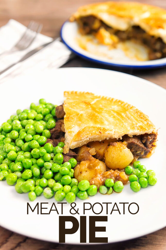 Portrait image of a slice of meat and potato pie served with garden peas on a white plate with the pie out of focus behind and text overlay