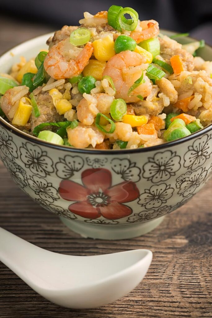 Portrait image of Chinese special fried rice served in an Asian style bowl decorated with a red flower