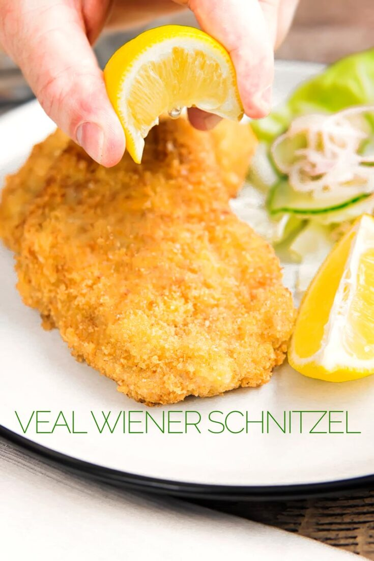 A good Wiener Schnitzel is typified by its simplicity, a perfectly fried bashed out veal cutlet coated in a golden crumb! #breadedmeat #schnitzel #vealrecipes #weeknightdinners #dinnerfor2