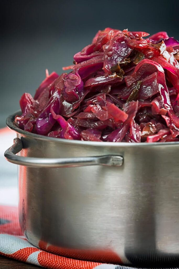 Portrait close up image of braised red cabbage served in a small aluminium pan