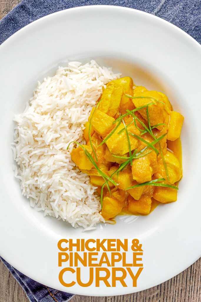 Portrait overhead image of a chicken and pineapple curry in a thick sauce with a chiffonade of green chilli and white rice served in a white bowl with text overlay
