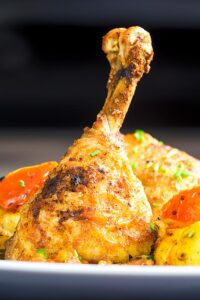Portrait close up image of Indian spiced roast chicken drumstick