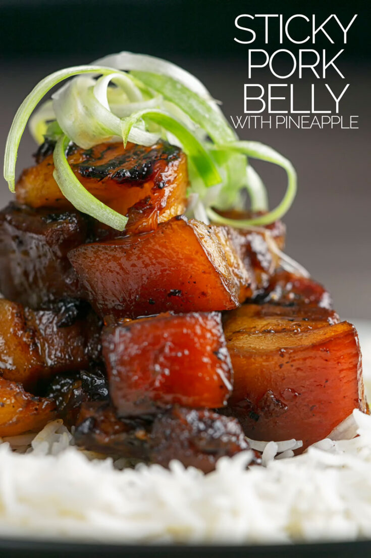 This delicious twice cooked sticky pork belly recipe is simply stunning, that rich pork with the fresh sweet and sour pineapple is a match made in heaven! #stickyporkbellyrecipes #chineserecipes #slowcookedbellypork #porkrecipes