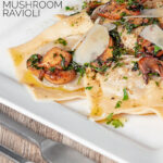 Portrait image of mushroom stuffed ravioli with balsamic mushrooms and Parmesan cheese shavings served on a white square plate with text overlay