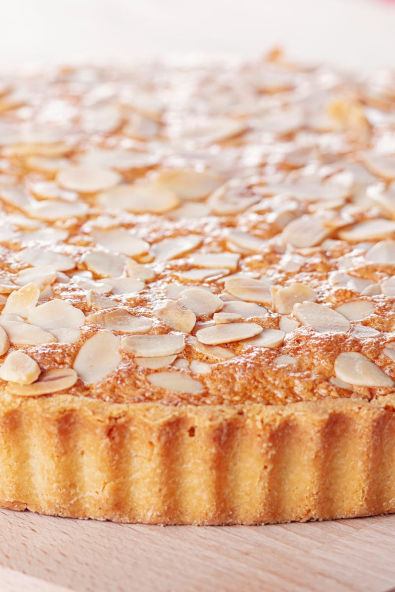 Portrait close up image of a Bakewell tart