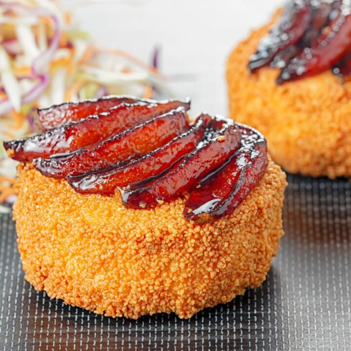 Square image of a fried Camembert Cheese with a balsamic pear topping