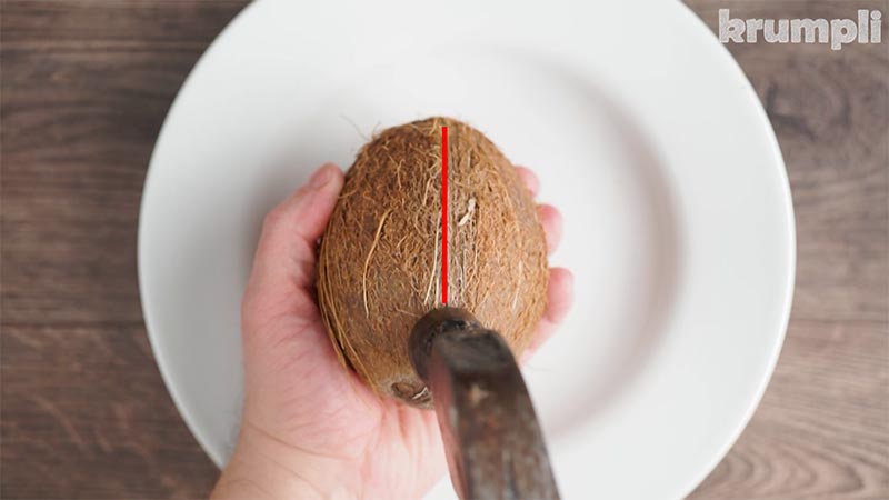 Hammer striking a seam when opening a coconut