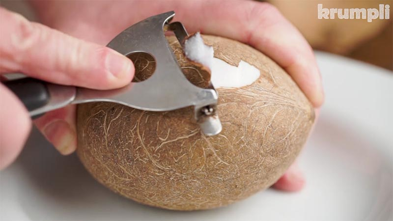 Peeling a coconut after opening
