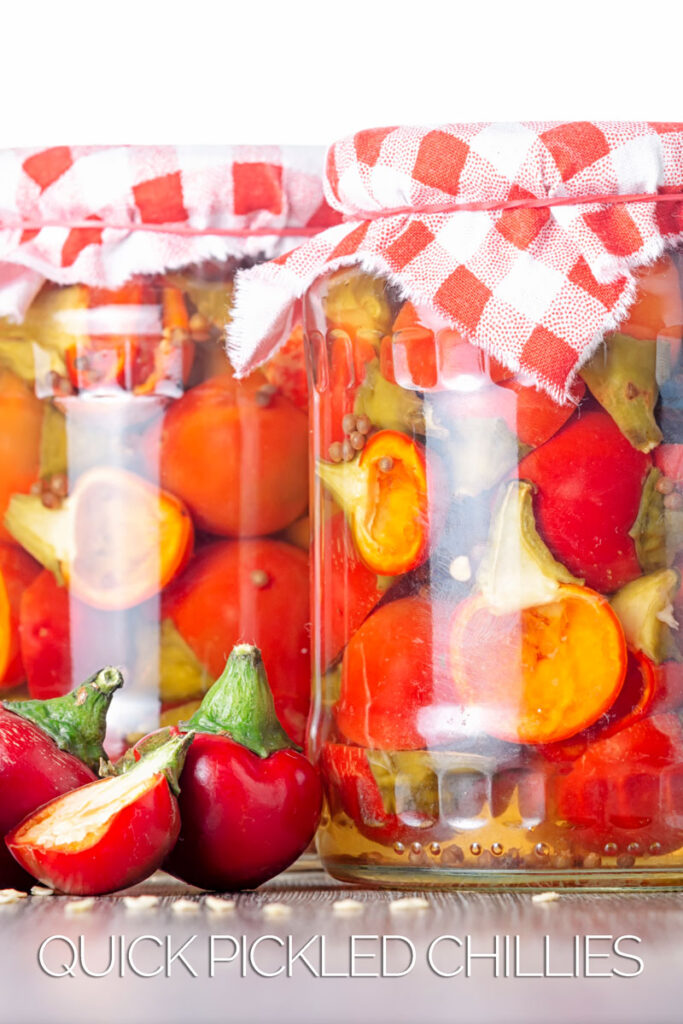Portrait image of cherry bomb chillies in front of jars full of pickled chilli with text overlays