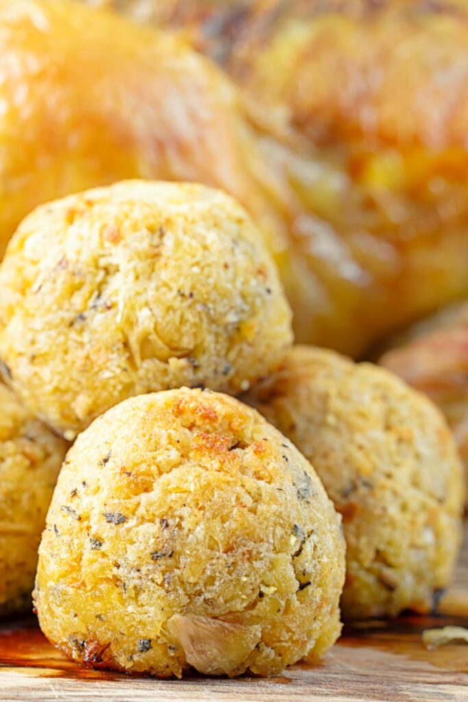 Portrait close up image of a pile of sage and onion stuffing balls