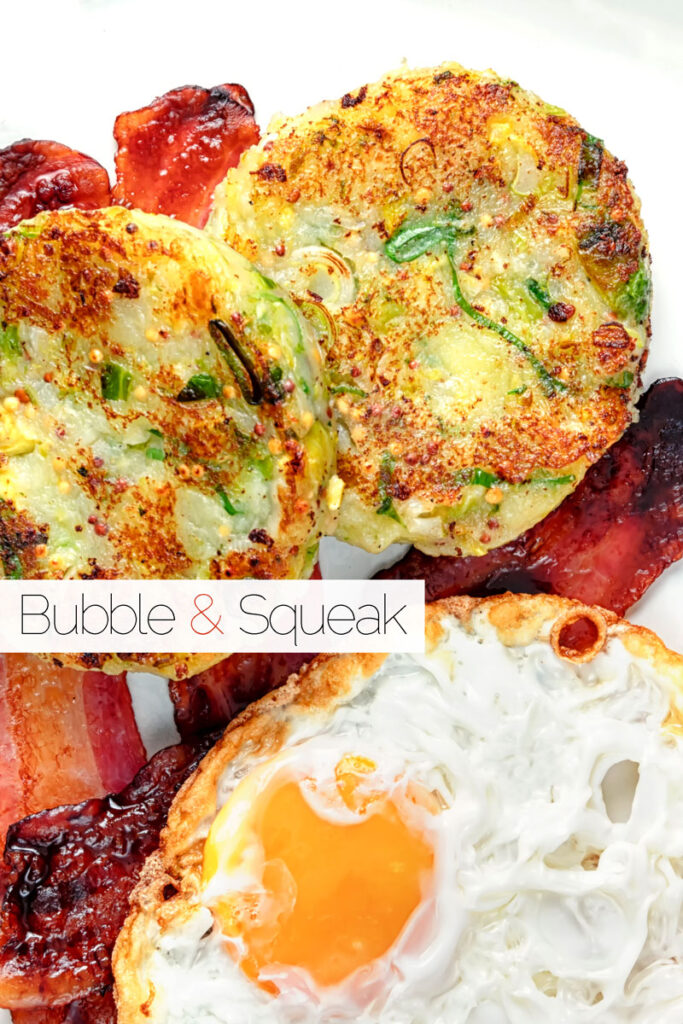 Portrait overhead image of traditional British bubble and squeak potato cakes served with fried egg and bacon with text overlay