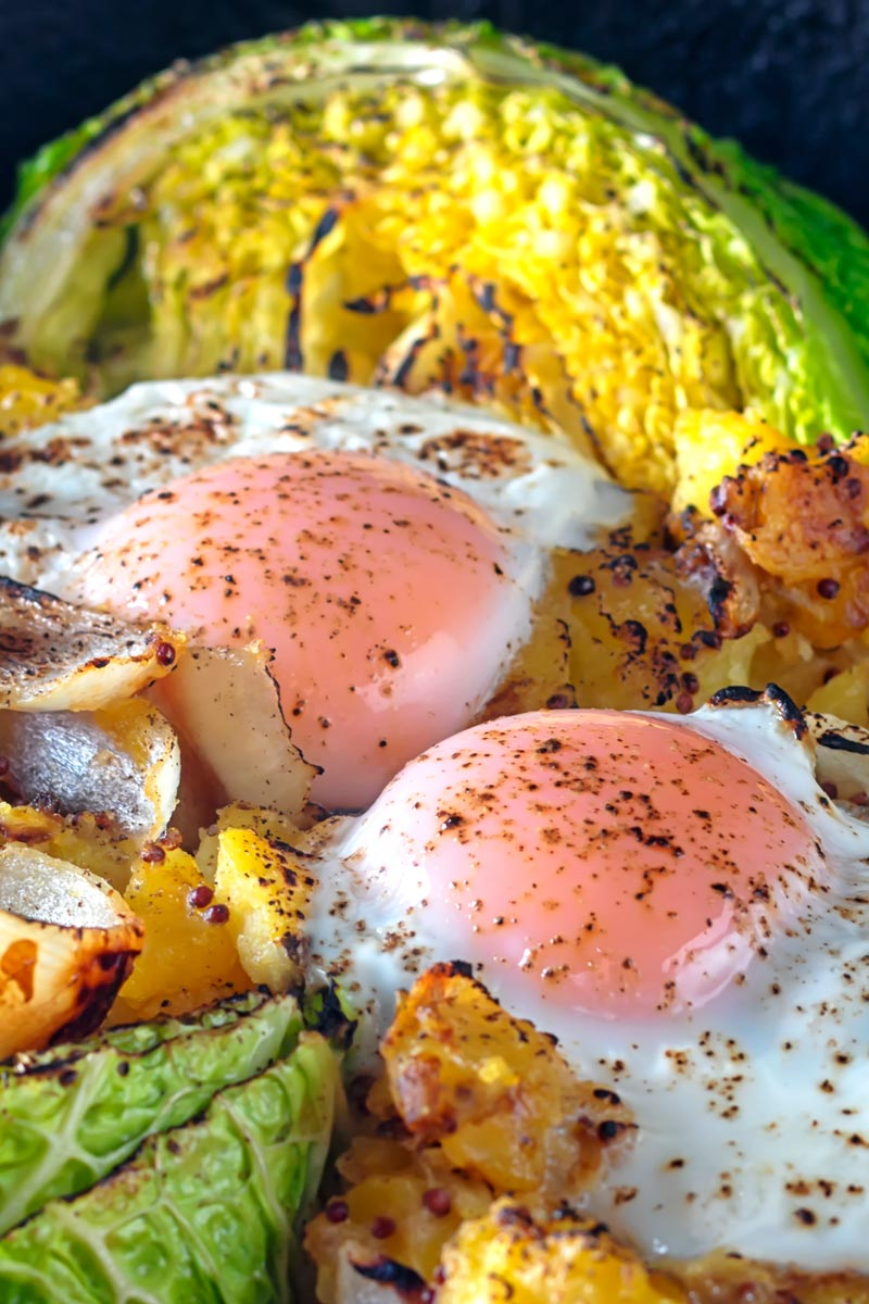 Portrait close up image of a cabbage and potato bake with eggs