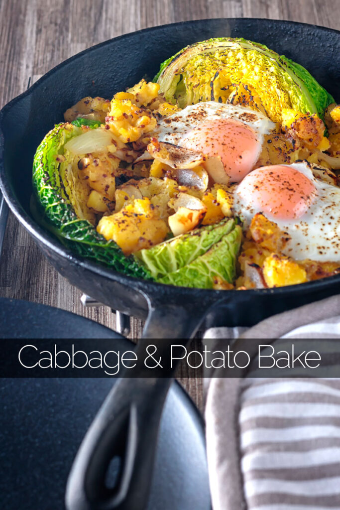 Portrait close up image of a cabbage and potato bake with eggs cooked and served in a cast iron skillet with text overlay