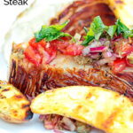 Portrait close in image of a balsamic cabbage heart steak served with tomato salad and potato wedges with text overlay