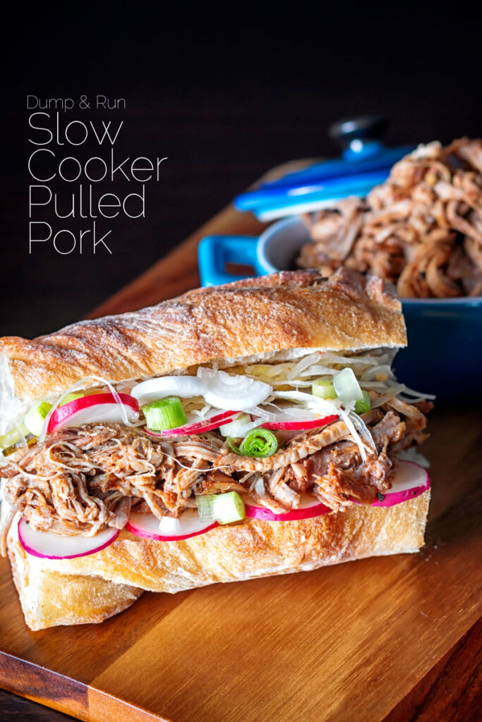 Portrait up image of a slow cooker pulled pork sandwich on a ciabatta style loaf with pickles with text overlay