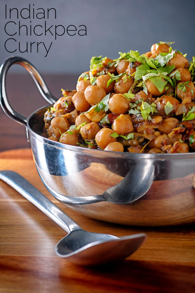 Portrait image of a chole or Indian chickpea curry garnished with chopped coriander served in a karahi with text overlay